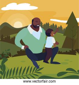 black father with son in the field