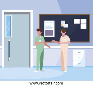 male medicine workers with uniforms in hospital corridor
