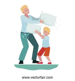 father and son playing with pillow