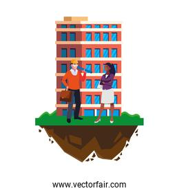 architect with afro female engineer and building
