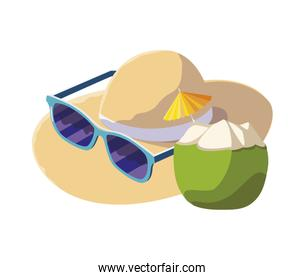fresh coconut cocktail with straw hat and sunglasses