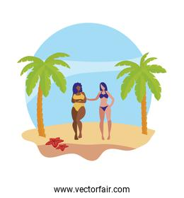 young interracial girls couple on the beach summer scene