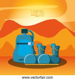 camping zone with boots and bottle