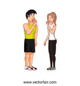 young athletic couple eating apple