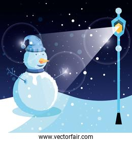 snowman with winter landscape and lamp