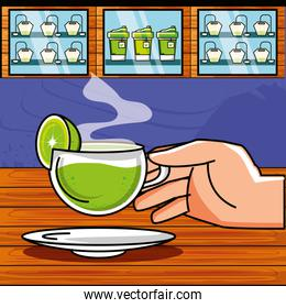 hand with delicious cup of tea and lemon