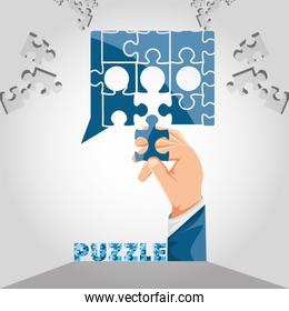 hand with puzzle pieces in shape speech bubble