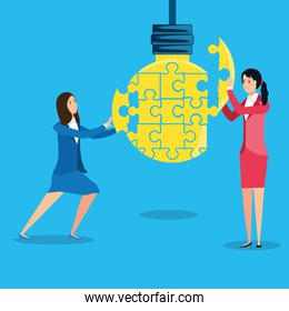 businesswomen with puzzle pieces in shape light bulb
