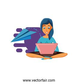 woman sitting with laptop computer and airplane paper