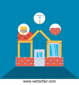facade of house under construction with set tools