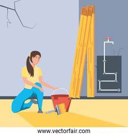 woman painting interior of house under construction