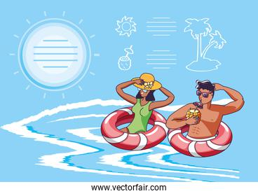 young couple in sea with floats summer scene