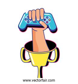 hand with video game control retro in trophy cup