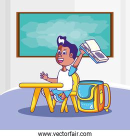 cute little student boy in the classroom