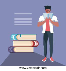 young man reading with stack of books