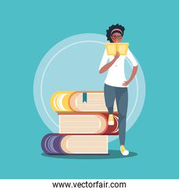 young woman reading with stack of books