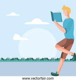 young man reading book in landscape