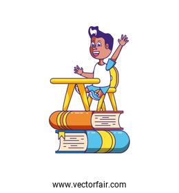 little student boy sitting in school desk with stack books