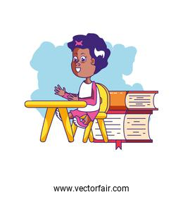 little student girl sitting in school desk with stack books