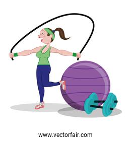 fitness woman jumping rope and fitball dumbbell