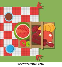 picnic basket food red and white blanket top view