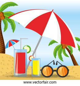 summer umbrella, sun glasses and cocktail over sand with a beautiful sunny beach
