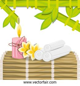 spa with towel candle and natural flower