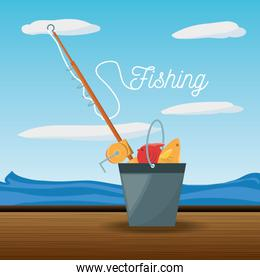 bucket with fish and rod