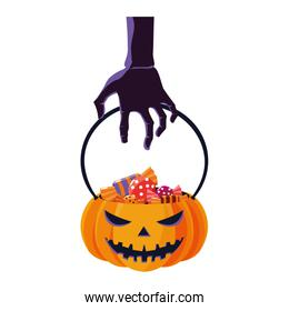 halloween zombie hand lifting pumpkin with candies