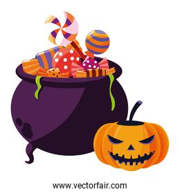 halloween pumpkin with cauldron and candies over white
