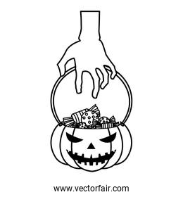 halloween zombie hand lifting pumpkin with candies over white