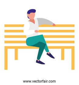young man sitting in the park chair