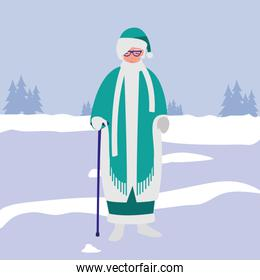 cute grandmother with cane and winter clothes