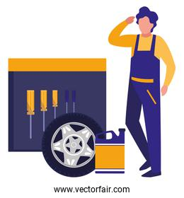 mechanic worker with tire car and tools