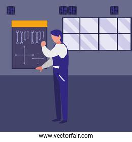 mechanic worker with tools board hanging