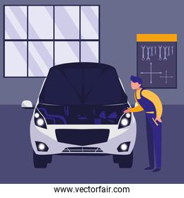 mechanic worker with car in the workshop