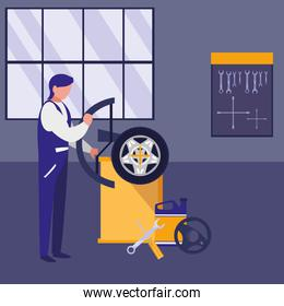 mechanic worker with tire changer machine