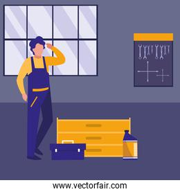 mechanic worker with toolbox in the workplace