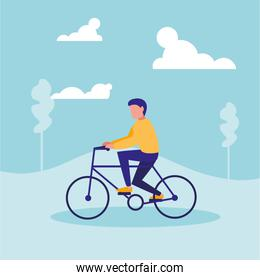 man practicing cycling in landscape