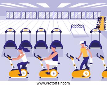 people riding spinning bicycle in sport gym