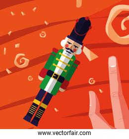 hand with nutcracker soldier toy icon
