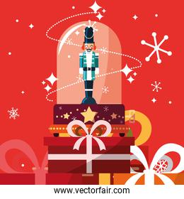 nutcracker soldier in crystal sphere with gift boxes presents