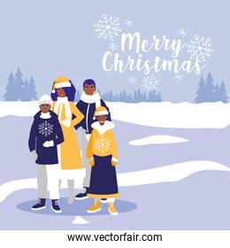 family black with clothes christmas in winter landscape