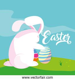cute rabbit with eggs of easter in grass