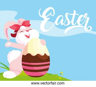 female rabbit and egg of easter decorated with candy