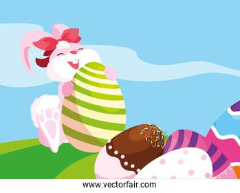 pink rabbit and eggs of easter decorated with candy