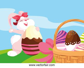 female rabbit and eggs of easter decorated with candy