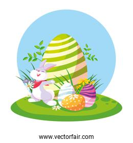 cute rabbit with eggs of easter in garden
