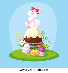 cute female rabbit with eggs of easter in garden