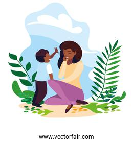 afro mother with son in scene nature